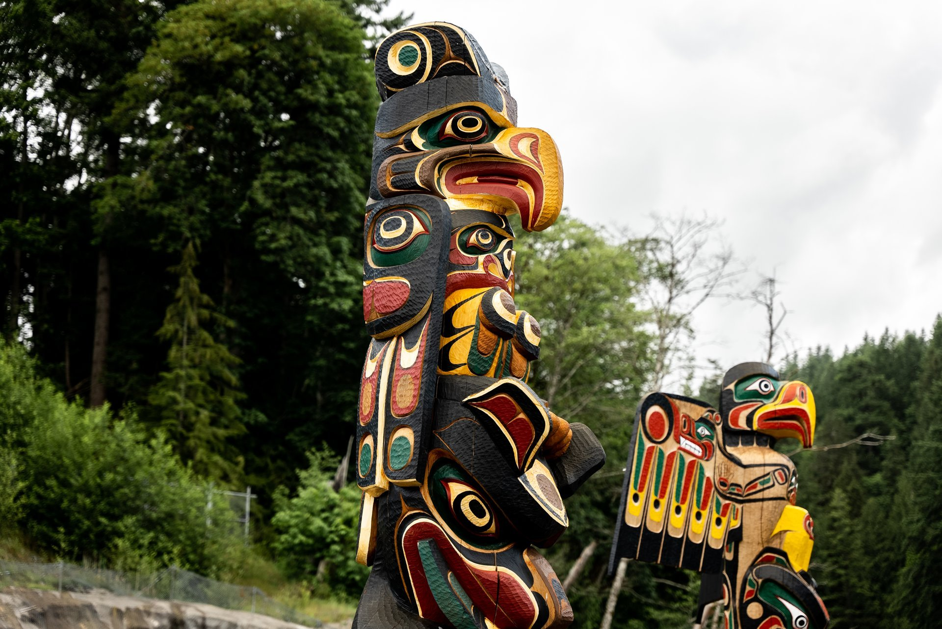 Find two totem poles from the We Wai Kai Nation and the Wei Wai Kum Nation on the Canyon View Trail. Image credit: Tyler Cave
